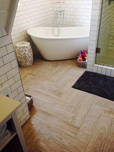 Herringbone patterned wood tile in our master bath