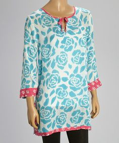 I'm not usually a flowery kinda gal but this just screams feminine and summer! Plus, it could easily transition into fall with some cute pink leggings. Turquoise & Pink Floral St. Tropez Notch Neck Tunic by Nomadic Traders #zulilyfinds