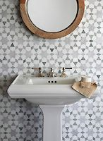 Medina, a natural stone waterjet mosaic shown in Ming Green, Carrara polished and Thassos honed, is part of the Miraflores Collection by Paul Schatz for New Ravenna Mosaics.