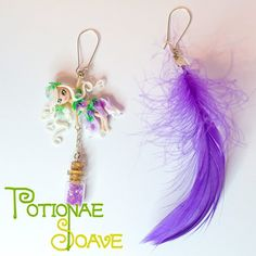 Pendant earrings, the pair consists in a Potionae Soave fairy and a purple synthetic feather. 100% hand-Made in Italy!  The fairies are entirely carved in every detail, no part has been painted: the eyes, the nuances of the body and all the other microscopic details are the result of a special treatment of the materials used. The earwires are made of silver plated alloy with a secure and durable closure.  Find it on www.Delicute.com