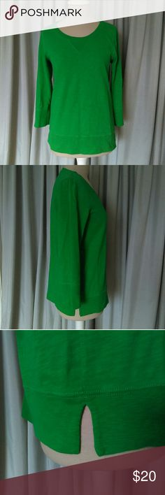 JCrew Kelly Green 3/4 Sleeve Top St. Patrick's Day 3/4sleeve women's shirt. 3 1/2 inch cuffs hem. 3 1/2 inch side slits at hem. Style is like a sweatshirt but medium/lightweight material. Would be a great shirt for celebrating St. Patrick's Day! Measurements in inches while laying flat are underarm to underarm: 18 1/2 inches, length: 25 inches .  Great, gently used condition. J. Crew Tops Tees - Long Sleeve