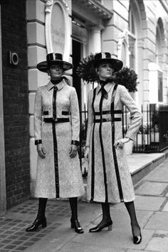 Two women in matching hats and Christian Dior coats
