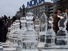 Ice Chess - Game over if it melts!  This was one of those games, played almost a fortnight back, where winning was a not a criteria.     The pawns were made from ice; some of these pawns were carved in a way that they represented various famous landmarks of the two cities. The game was held on a chessboard measuring 64 square yards, with each team being allotted 30 seconds for each move.