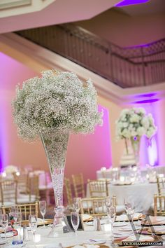 Babys Breath Centerpieces - love these. Ice in the bottom and LED light
