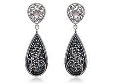 """Sutra's earrings are made in 18-karat gold with black jade, diamonds and moonstone (price upon request).    The use of jade in jewelry was also prominent at the show and in jewelry now.    """"I think that overall, there is from a style perspective, a very big Asian influence in jewelry right now,"""" O'Connor says. """"I'm seeing a lot of designers use really interesting color mixes, and then also Asian stones like jade."""""""