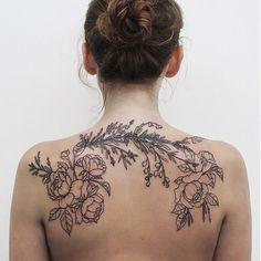 Beautiful floral back tattoo.