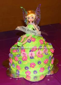 Homemade Tinkerbell Cake: I used 2 9 pans on the bottom and a glad bowl for the top of this Tinkerbell cake.  I topped it with a Tinkerbell doll and added the happy birthday banner