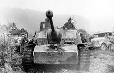 A Sturmgeschütz III rolls past destroyed American vehicles during the beginning of the Battle of the Bulge. #WW2