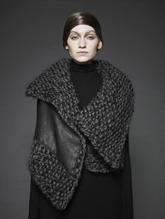 love the large knit w/ the partial outer shell in leather  --  Sunghee Bang FW12