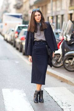 A dark blue double breasted blazer and a navy midi skirt will showcase your sartorial self. A pair of black leather booties will seamlessly integrate within a variety of outfits.  Shop this look for $299:  http://lookastic.com/women/looks/scarf-turtleneck-double-breasted-blazer-clutch-midi-skirt-socks-ankle-boots/4908  — Grey Silk Scarf  — Grey Turtleneck  — Navy Double Breasted Blazer  — Black Leather Clutch  — Navy Midi Skirt  — Grey Socks  — Black Leather Ankle Boots