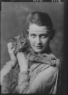 Woman with Buzzer the cat, (by Arnold Genthe, c. 1913)