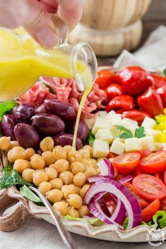 You will love this easy recipe for Italian Antipasto Salad that is loaded with veggies, meat, cheese and a lemon vinaigrette dressing. Make it big for a main course or smaller for side salads. #antipasto #italian #salad #lemonvinaigrette