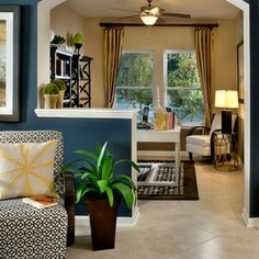 The blue color is PPG Paints 549-7 Calvary Inside the study above the chair rail is PPG  Paint color 414-3 Toasted Almond and below chair rail is PPG  Paint color 513-6 Dark Ash. The underside of arch is the trim paint: PPG 315-1 Horseradish by PPG Paints!   traditional living room by David Weekley Homes