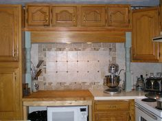 moved fridge to new location & moved short cabinet that was above old stove & added it to short cabinet that was above fridge