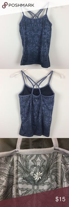 """ATHLETA Harmonious Tank Style 581305 Ombre Gray ATHLETA Style #581305 Ombré Granite Gray Tie Dye Floral Harmonious Printed Cami Tank. Ombre. Size Small. Removable pads. Criss Cross Racerback straps. Athleta logo on back. Please see up close photos to see the true color. *Pit to Pit 14"""" *Length from armpit 15"""" *Condition: Good pre-owned condition. Logo on back and brand name in back inside are starting to peel off slightly. Please see close up photos. • A17 Athleta Tops Tank Tops"""