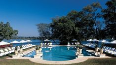 Priced from USD 475 the Royal Livingstone Hotel in Zambia on the Zambezi River is superiour luxury with a direct walkway to Victoria Falls. David Livingstone, Victoria Falls, Natural Wonders, Best Hotels, Wonders Of The World, Waterfall, National Parks, Places, Travel