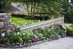This is the \look\ I'm shooting for with my borders. (By Troy Rhone garden design)