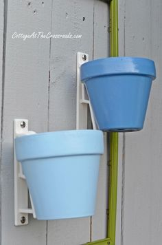 terracotta pot holders and painted pots | Cottage at the Crossroads