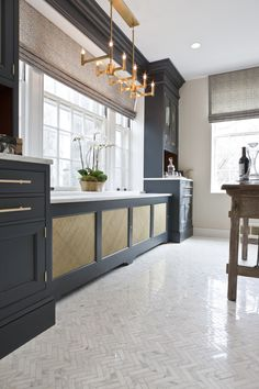 "says it is calcutta marble but looks more cream? Wood-Mode's new vintage navy was our first and only choice for the cabinetry,"" says Subaran. ""The deep navy, calcutta marble floors and cou. Transitional Living Rooms, Transitional House, Transitional Lighting, Interior Exterior, Interior Design, Cocina Office, Wood Mode, Cocinas Kitchen, Eclectic Kitchen"