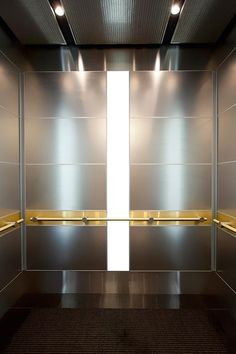 LEVELe-107 Elevator Interior with customized panel layout; panels in Stainless Steel with Seastone finish, LightPlane in ViviChrome Chromis glass with White interlayer and Opalex finish, custom insets; Compass handrail at 225 West Washington Street, Chicago, Illinois