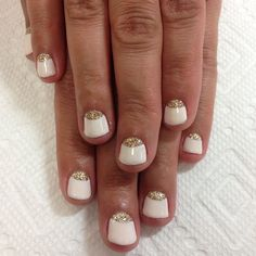 Off white and gold moon French gel nail design.