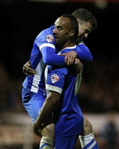Solly March Photos Photos - Chris O'Grady of Brighton & Hove Albion celebrates his goal with Solly March during the FA Cup Third Round match between Brentford v Brighton & Hove Albion at Griffin Park on January 3, 2015 in Brentford, England. - Brentford v Brighton & Hove Albion - FA Cup Third Round