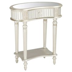 Perfect for displaying a vase of lush blooms or an artful candle arrangement, this lovely console table showcases a mirrored top and 1 drawer.