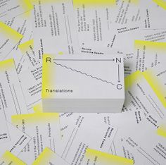 Yellow edge sprayed grey business card designed by Studio Constantine for translator Renata Noronha Cossio.