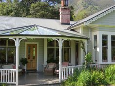 Exteriors painted in resene greens - a relaxed country feel