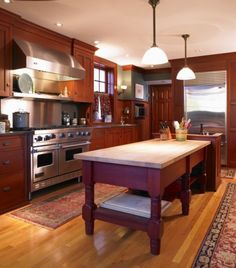 K-3..Stained cherry kitchen island-table and cabinetry