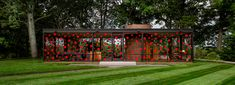 yayoi kusama dots philip johnson's glass house in a red polka pattern