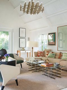 Give your existing palette a pick-me-up with playful patterns and rich autumnal hues. The timeless white walls and neutral seagrass rug make this living room a canvas for fall color. Throw pillows tempered with playful hues and a mix of graphic, nature-inspired patterns create a lively, upbeat mood.