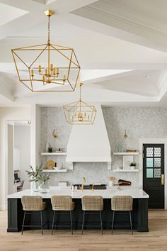 Stunning black and white dream kitchen. I love the gold/brass accents!