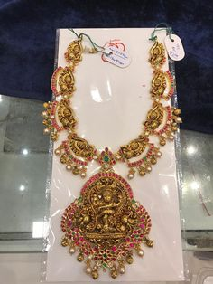 Stunning gold necklace with lord Nataraj pendant. Necklace studded with rubies and emeralds. Necklace with pearl and gold ball hangings. 26 May 2019 Bead Jewellery, Bridal Jewellery, Wedding Jewelry, Gold Jewelry, Latest Jewellery, Temple Jewellery, Jewlery, Jewelry Necklaces, Antique Jewellery Designs