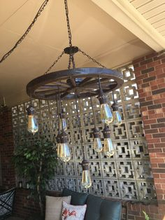 Wagon Wheel Chandelier with Vintage Bulbs by SouthernCharmByKaren Wagon Wheel Light, Wagon Wheel Decor, Wagon Wheel Chandelier Diy, Diy Chandelier, Cottage Lighting, Farmhouse Lighting, Deck Lighting, Barn Lighting, Bicycle Decor