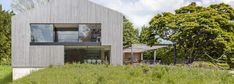 House in Oxfordshire | Peter Feeny Architects | Archello Solar Heating Panels, Natural Swimming Ponds, Pv Panels, Cladding Materials, Garage Roof, Game Room Basement, Wood Pellets, Hill Park, Glass Roof