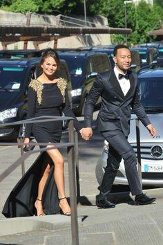 Chrissy Teigen and John Legend attending the #KimyeWedding.