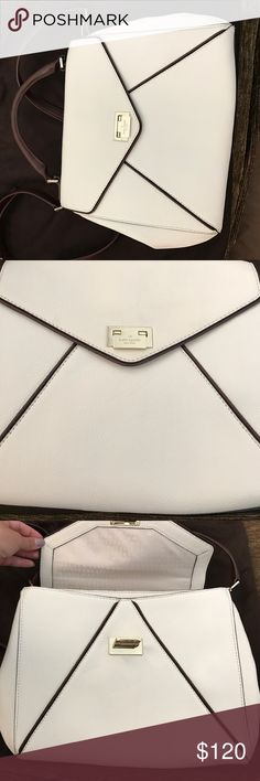 Kate Spade New York handbag White with brown trim Kate Spade handbag, very good condition used 1-2 times kate spade Bags Crossbody Bags