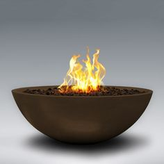 great bowls of fire! unfortunately they're not cheap, but what a cool way to enjoy a fire in the garden on a cool night.