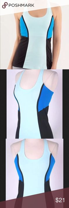 """LULULEMON ATHLETICA Blue COLOR BLOCK TANK TOP $68 Color: Royal blue, aqua blue, and black  Fabric: Nylon/spandex. Stretch: Yes. Retail Value: $68. Scoop neck line, Flattering princess seams, Color block design, Racerback, Lululemon logo on back *No built-in bra*. Size label is missing. check measurements to ensure proper fit. Bust: 13.5"""" (taken from armpit to armpit) Length: 15"""" (taken from armpit to hem) Measurements are taken with item laid flat, unstretched. Condition: Excellent! Fabric…"""