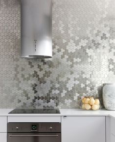 Contemporary Kitchen by ALLOY Solid Metal Tiles etallic tiles. Metallic tiles add some shine in unexpected places, such as shower walls, kitchen backsplashes and fireplaces, and can even just be wall accents.