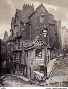 "The junction of Steep Street and Trenchard Street, Bristol, England 1866 [[MORE]] Some detail: John Hill Morgan (b platinum print. ""R Holloway Dealer in Marine Stores"" Locals would have called this a ""rag and bone shop"". Victorian London, Victorian Street, Vintage London, London 1800, Victorian Ladies, Vintage Pictures, Old Pictures, Old Photos, Victorian Pictures"