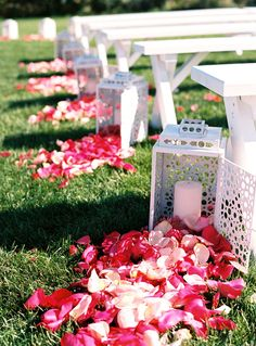 A charming ceremony idea: Line your aisle with rose petals cascading from classic white lanterns!