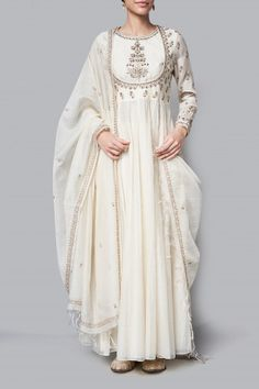 The white chanderi suit, is embroidered with floral motifs that remind you of lush beautiful gardens of summer. The Amaara kurta, paired with a churidar and dupatta, is the perfect addition to your summer wardrobe. Kurta Designs, Kurti Designs Party Wear, Indian Fashion Dresses, Dress Indian Style, Pakistani Dress Design, Pakistani Dresses, Indian Wedding Outfits, Indian Outfits, Stylish Dresses