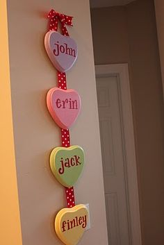 "Convo Hearts Wall Hanging This wall hanging would be SO fun to make with the kids' names on it or even with cute little convo hearts saying on it like, ""Be Mine""! 25 DIY Valentine's Day Decorations - Brittany Estes"