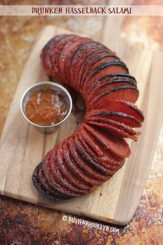 Drunken Hasselback Salami - accordion-sliced baked salami with an apricot brandy sauce : busyinbrooklyn Meat Appetizers, Appetizers For Party, Appetizer Recipes, Salami Appetizer, Kosher Recipes, Cooking Recipes, A Food, Food And Drink, Bratwurst