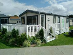 Fensys are leading manufacturer of high specification low maintenance plastic decking, plastic gates and plastic fencing. Plastic Fencing, Decking Suppliers, Hand Railing, Caravan Home, Caravan Holiday, Led Manufacturers, Tiny House Plans, Caravans, Decorating Tips