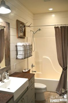 Rustic Bathroom Renovation - shiplap walls and salvaged and repurposed wood and materials were used to create this masculine bathroom. There are a lot of creative decorating ideas on this post - via The Pink Tumbleweed