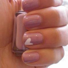 Red nails, white heart on each finger