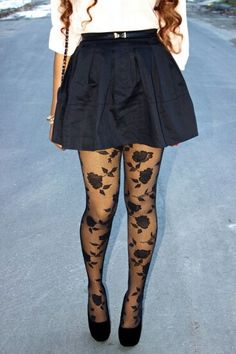 black skirt paired with rose tights